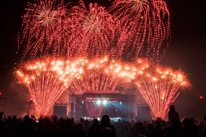 Colorful fireworks above the stage during concert